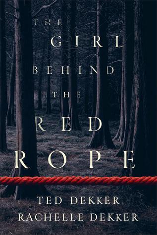 Girl behind red rope